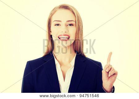 Young blonde businesswoman explaining something