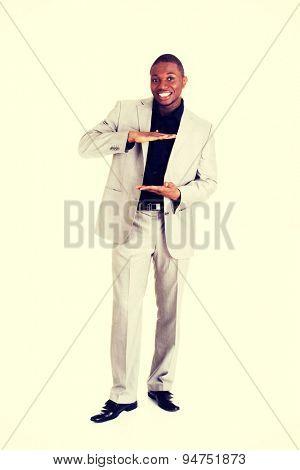 Handsome black businessman gesturing frame