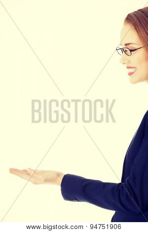 Beautiful blonde businesswoman presenting something