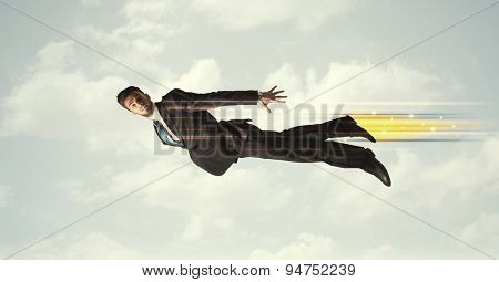 Happy business man flying fast on the sky between clouds concept