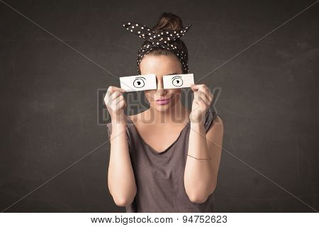 Funny woman looking with hand drawn paper eyes concept