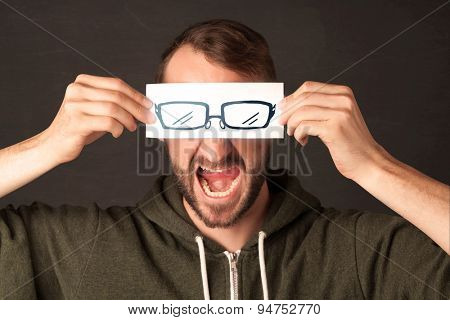 Happy guy looking with paper hand drawn eye glasses concept