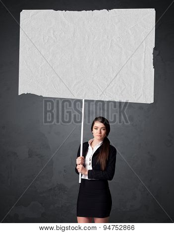 Young businesswoman holding a big blank booklet paper