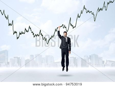 Businessman hanging on a graph rope
