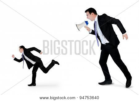Business man screaming on megaphone on little man