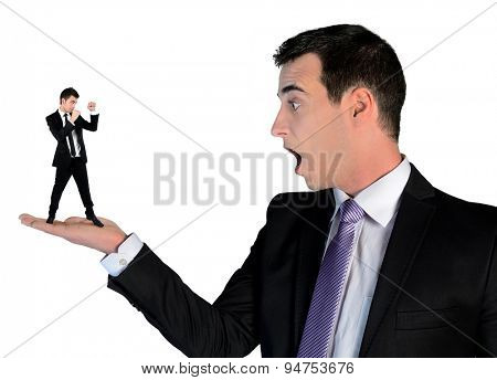 Isolated business man looking shocked on little man