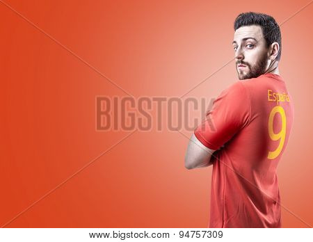 Spanish soccer player on red background