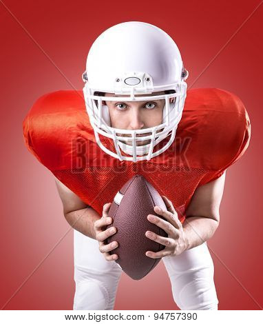 Football Player on red uniform on red background