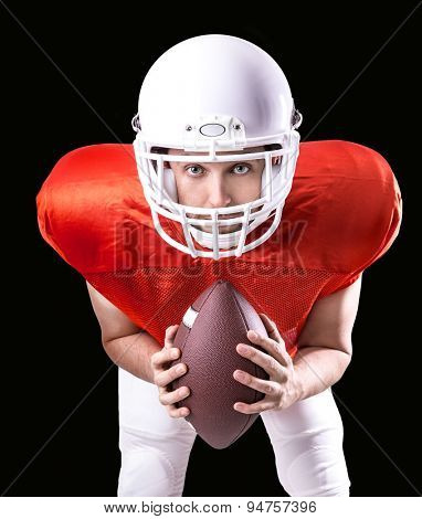 Football Player on red uniform isolated on black background