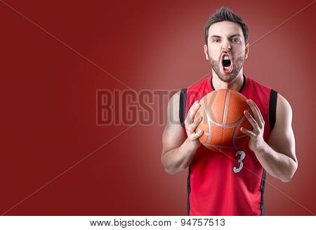 Basketball Player on a red uniform on red background