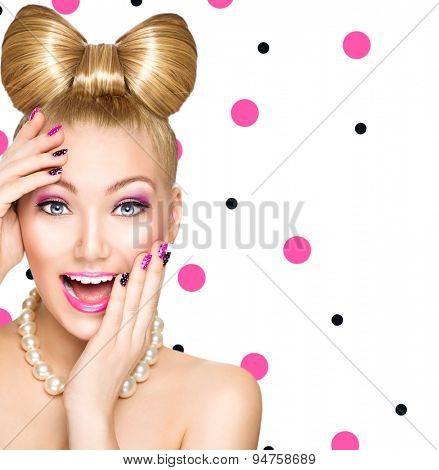 Beauty fashion happy surprised model girl with funny bow hairstyle, pink nail art and makeup isolated on white background with polka dots. Laughing retro styled young woman. Emotions
