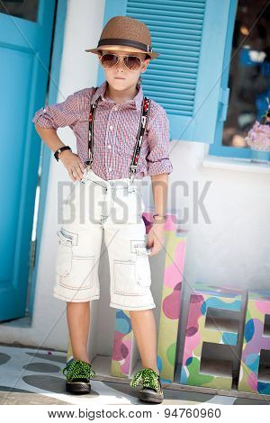 Funny child. Fashionable little boy in sunglasses and hat. Fashion children