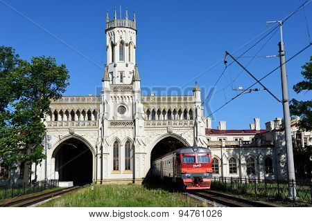 ST. PETERSBURG, RUSSIA - JUNE 7, 2015: Commuter train arrives to the train station Novy Peterhof. The station was built in 1854-1857 by design of N Benois