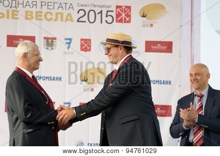 ST. PETERSBURG, RUSSIA - JUNE 12, 2015: Ex World and Olympic champion Vyacheslav Ivanov (left) during the award ceremony of the Golden Blades Regatta. It is is one of the best known regatta in Russia