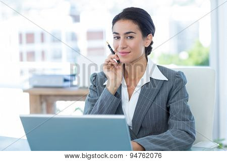 Businesswoman using laptop in an office
