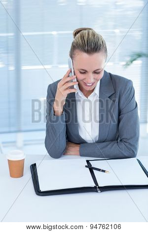 Smiling businesswoman having phone call in the office