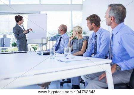 Business people listening during meeting in office