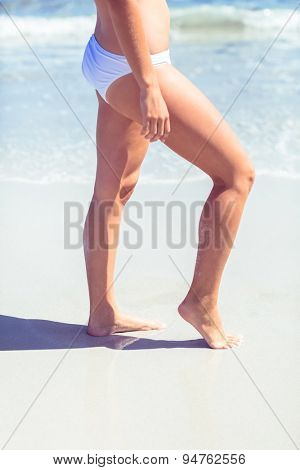 Close up view of woman leg at the beach