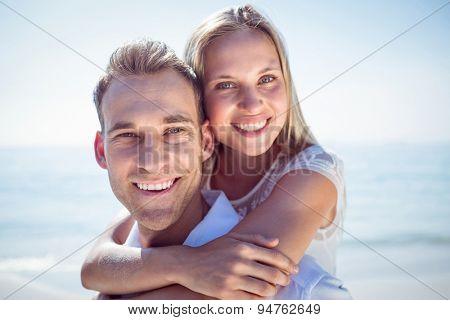 Happy couple on the beach on a sunny day