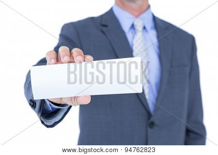 Businessman holding a white sign on white background