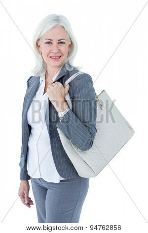 Businesswoman with bag against white background