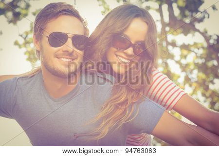 Cute couple having fun in park on a sunny day