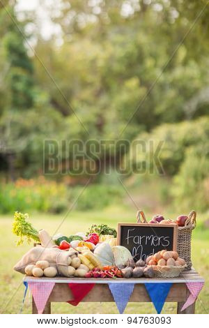 Table with locally grown vegetables in the park