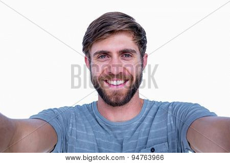 Handsome man smiling at camera on white background