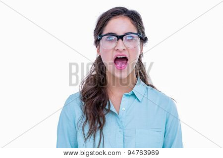 Surprised geeky hipster with her mouth open on white background