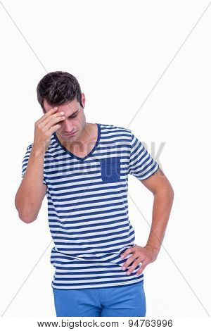 Sad hipster with one hand on head on white background
