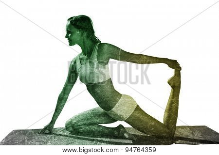 Gorgeous fit blonde in seated yoga pose against scenic view of walkway along lush forest