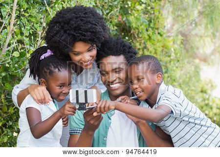 Happy family taking a selfie in the garden at home