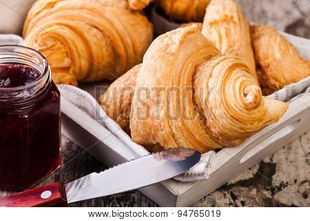 Fresh Croissants on wooden rustic background