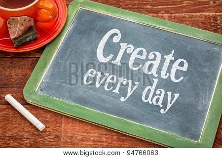 Create every day motivational reminder - motivational text on a slate blackboard with chalk and cup of tea