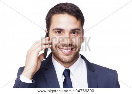 Smiling business man talking on the cell phone, isolated on white background