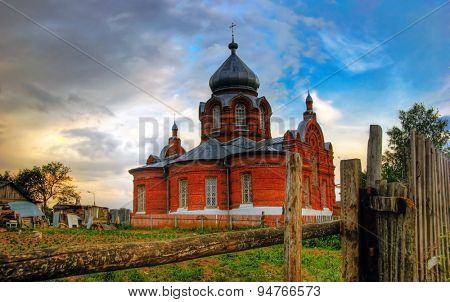 Old russian church in gloomy weather in sunset time