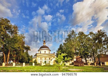 Old russian church under blue evening sky. fisheye lens