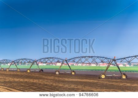 Automated Farming Irrigation Sprinklers System In Operation