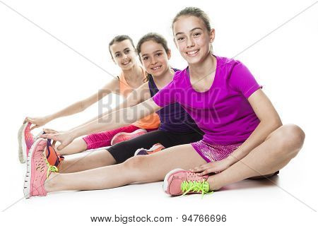 running young girl in sport cothes, white background