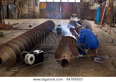 Welders Reparing Ship Parts