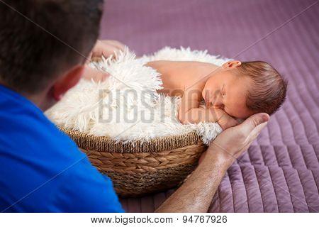 Photographer at work with newborn baby boy