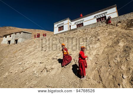 KORZOK, INDIA - SEPTEMBER 15, 2012: Children Buddhist monks throwing paper planes in Korzok village,  Ladakh, India