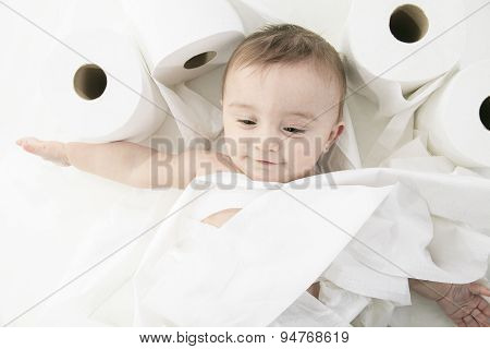 Toddler ripping up toilet paper in bathroom studio