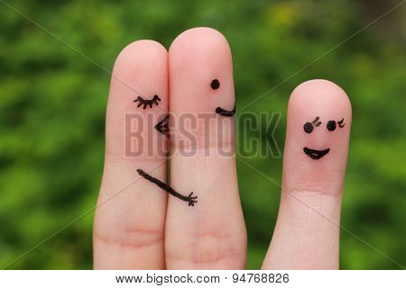 Finger art of a couple. Woman hugs and kisses the man, and he's flirting with another woman.