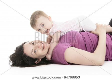 Studio Portrait Of Mother With Young Baby girl