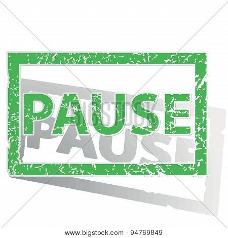 Green outlined PAUSE stamp