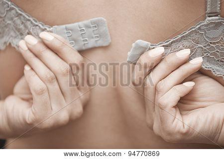 Woman Undressing Brassiere