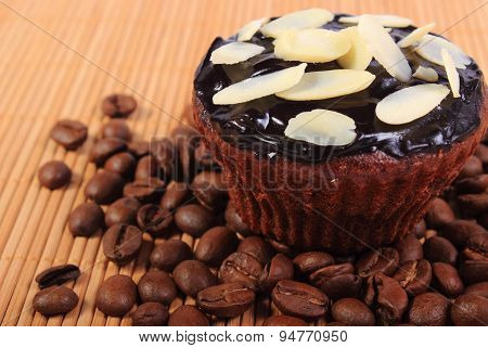 Chocolate Muffins With Sliced Almonds And Coffee Grains