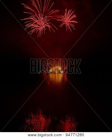 Colorful Fireworks With Reflection On Lake.