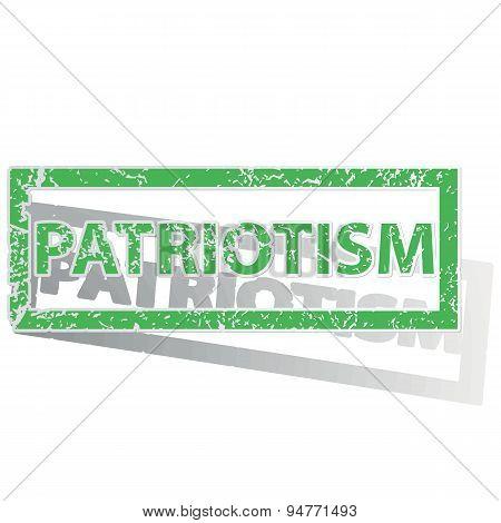 Green outlined PATRIOTISM stamp